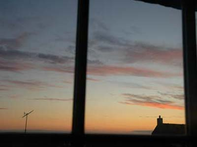 The turbine, normally a source of sustainable energy for The Manse, sleeps on a still evening