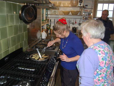 Hannah (Finnish student) cooking Fattie Cutties with Barbara