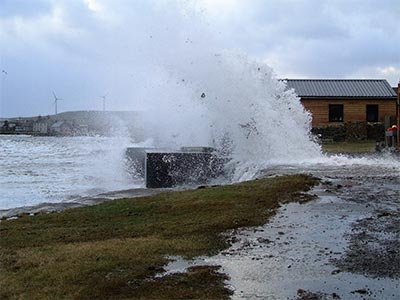 High tide in a gale; winter lets can be exciting to watch but fear not there are SEPA approved flood defences(raised sea wall, concrete filled stone dyke & flood gate) between the cottage and the bay…